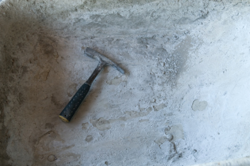 How to Pour a New Concrete Slab Over an Old Concrete Slab