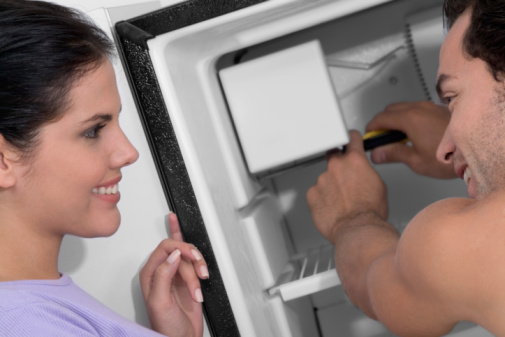 How to Remove the Dispenser Front on a Whirlpool Refrigerator