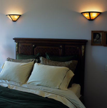 How to Attach a Wooden Headboard to a Metal Frame