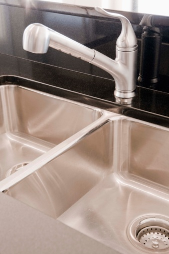 Caulking Kitchen Sink How to caulk a kitchen faucet hunker step 1 workwithnaturefo