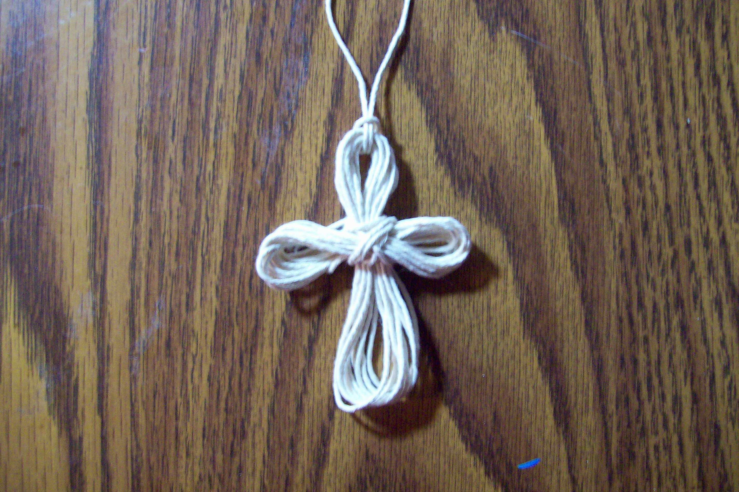 How to make a paracord cross necklace with two strings ehow for What can you make out of paracord