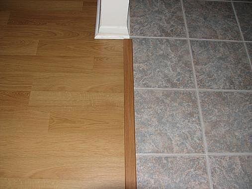 Hardwood flooring vs travertine tile ehow for Hardwood floors vs tile
