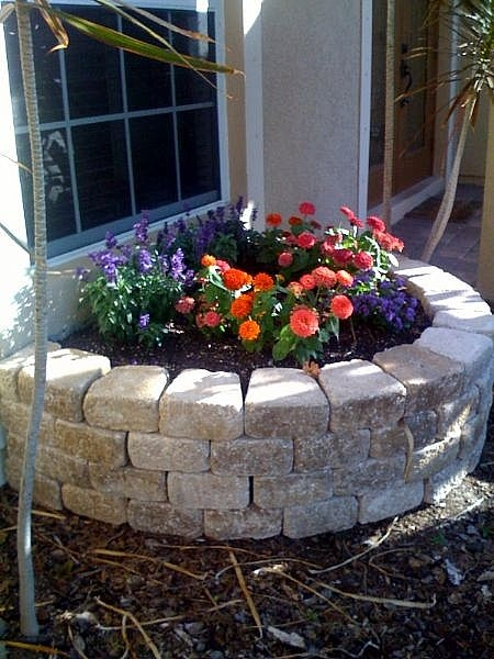 How to create a retaining wall around a tree ehow for Creating a flower bed