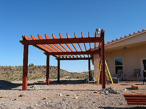 how to build a pergola attached to house ehow. Black Bedroom Furniture Sets. Home Design Ideas