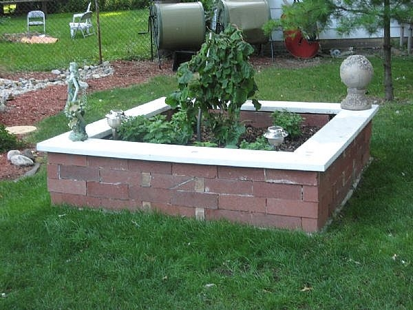 Cement Raised Flower Beds : How to create landscape edging use angled bricks ehow