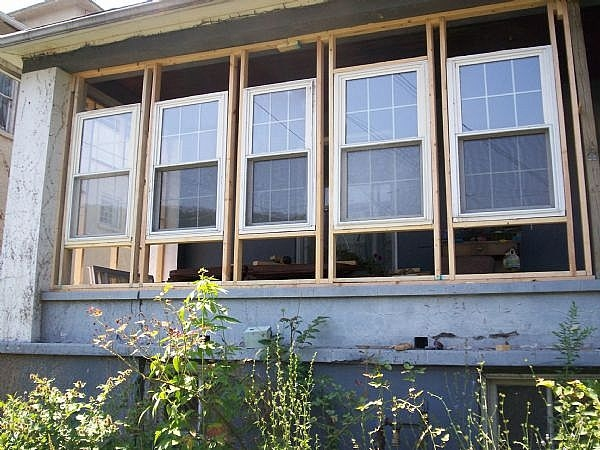 Options to enclose screened lanai windows ehow for How to enclose a screened in porch