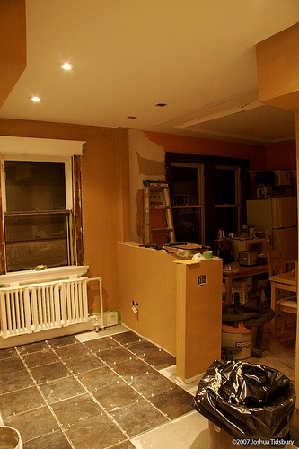 How to make a half wall between the kitchen the living room ehow for Half wall between living room and dining room