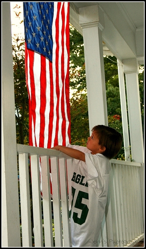 How to display an american flag on a house ehow for Flag etiquette at home