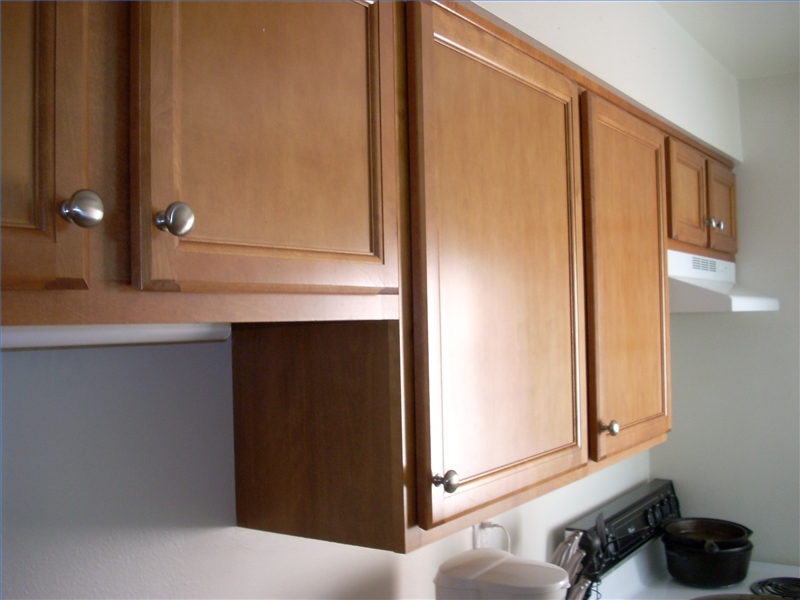 How to install ceiling mounted kitchen cabinets ehow for Ceiling mounted kitchen cabinets