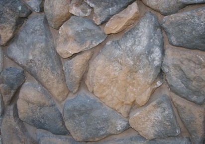 How to install river rock on a fireplace surround ehow for Laying river rock