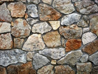 How to install stone over stucco ehow for How to install stone veneer over stucco