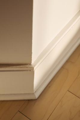 What Baseboard Is Better: Plastic or Wood?
