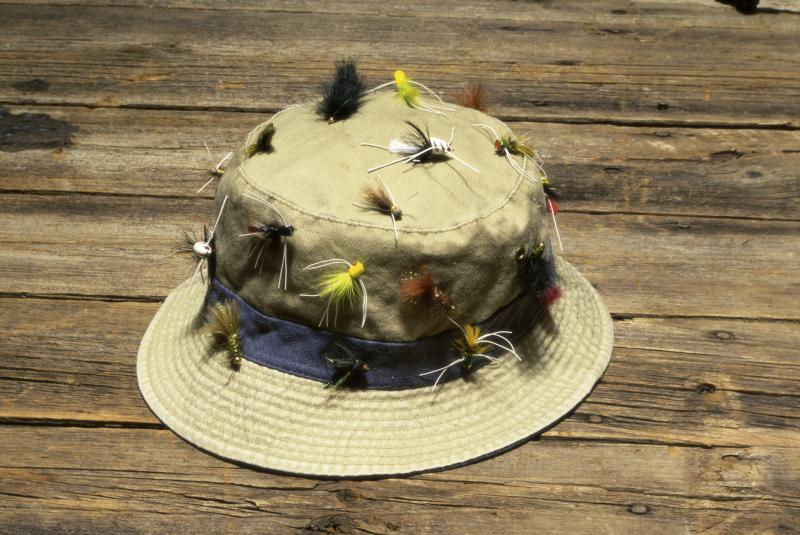 How to put a fishhook on a hat gone outdoors your for Fishing hooks for hats