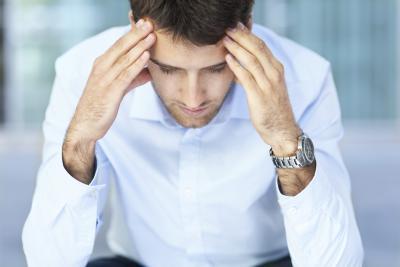 man with developing headache