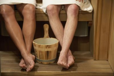 Two males in a sauna.