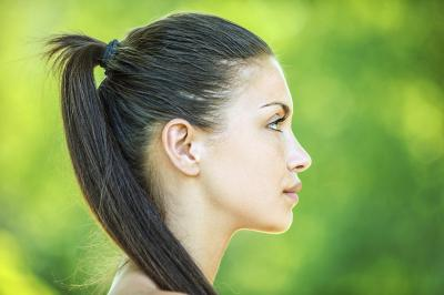 woman with tight ponytail