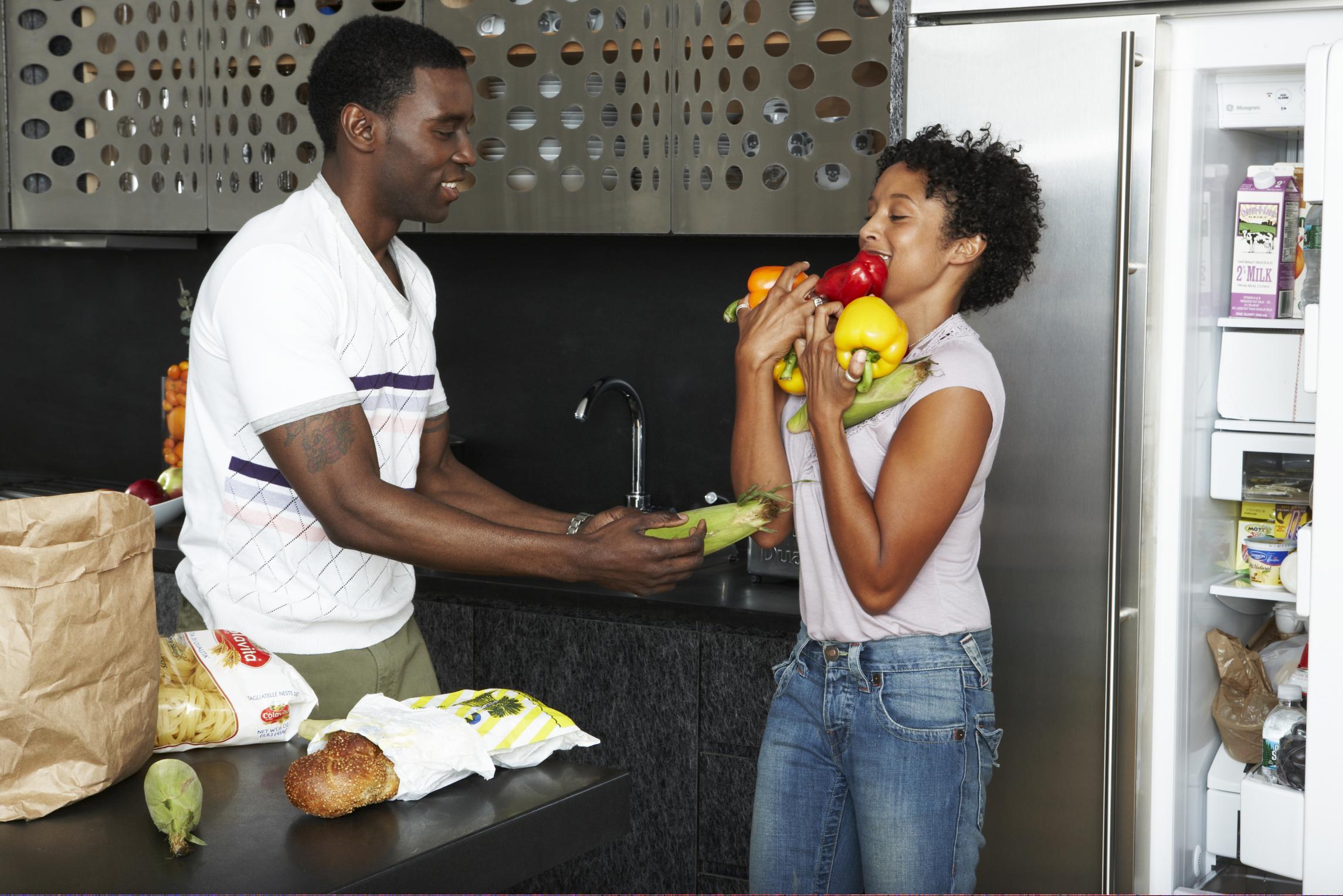 A man, woman, their groceries