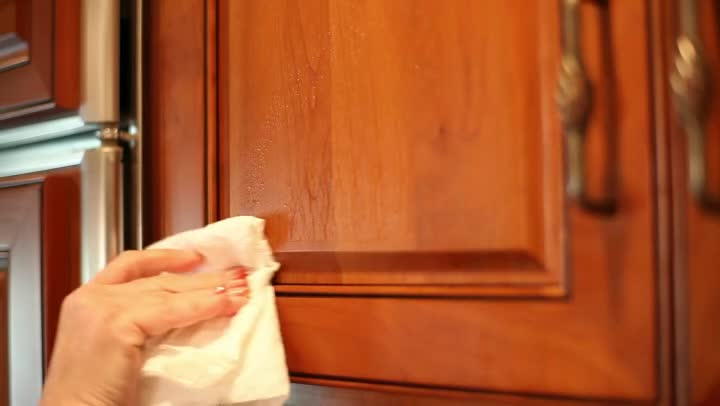 Video how to remove greasy film from kitchen cabinets ehow for Best cleaner for greasy wood kitchen cabinets