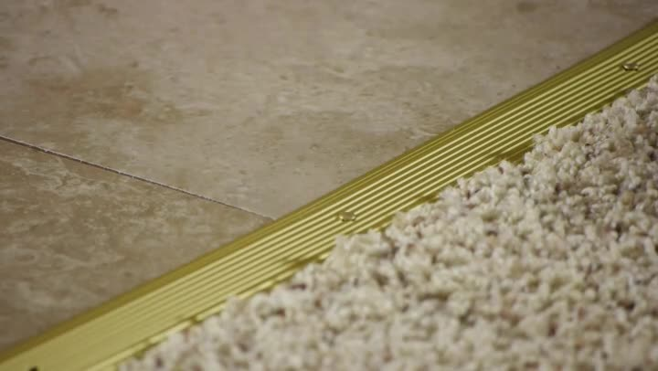 Video how to install a transition strip from carpet to for Wood floor 90 degree turn