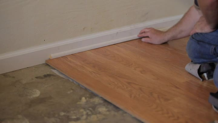 Video how to install laminate flooring without removing for Installing laminate wood flooring