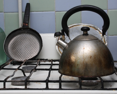 how to clean oil spill on stove