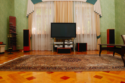 How to Hide Speaker Wire With Hardwood Floors